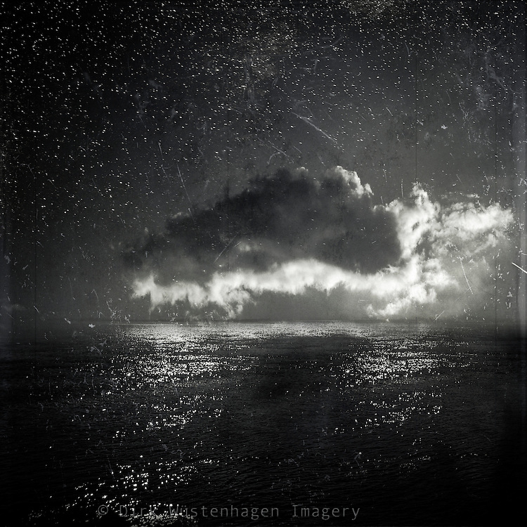 Composing of a cloud picture and a pic of the calm North Sea.<br />