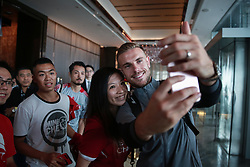 HONG KONG, CHINA - Monday, July 17, 2017: Liverpool's captain Jordan Henderson shares a selfie with a supporters as the squad arrive at the Ritz-Carlton Hotel in Kowloon, Hong Kong, ahead of the Premier League Asia Trophy 2017. (Pic by FA Premier League/Pool/Propaganda)