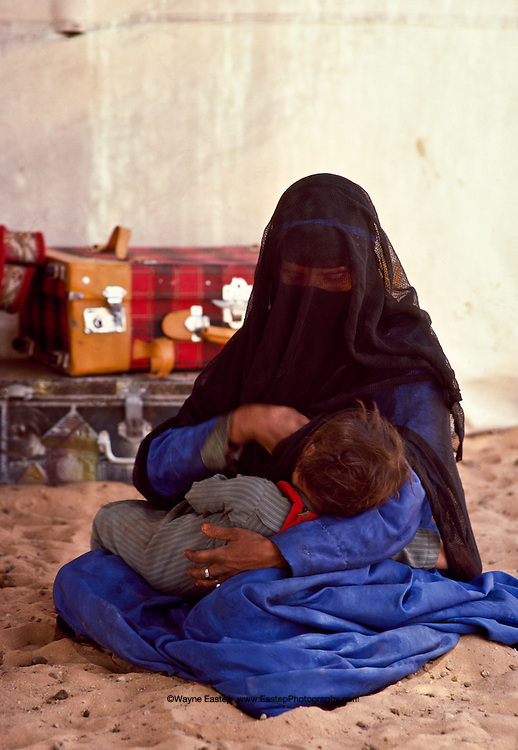 Shammer woman with her baby in their tent in The Nafud, Saudi Arabia.