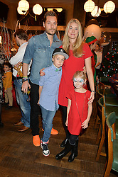 SEB & HEIDI BISHOP and theirchildren MAX BISHOP and SKYE BISHOP at a party hosted by Camila Batmanghelidjh for Kids Company held at The Ivy Market Grill, 1 Henrietta Street, Covent Garden, London on 23rd November 2014.