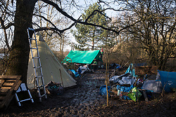 Harefield, UK. 18 January, 2020. The Colne Valley wildlife protection camp which was reoccupied by activists from Extinction Rebellion, Stop HS2 and Save the Colne Valley on the second day of a three-day 'Stand for the Trees' protest in the Colne Valley timed to coincide with tree felling work by HS2. Bailiffs acting for HS2 had evicted all but two activists from the camp the previous week. 108 ancient woodlands are set to be destroyed by the high-speed rail link.