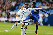 Lee Gregory of Millwall (l) is challenged by Bruno Ecuele-Manga of Cardiff city &reg;. EFL Skybet championship match, Cardiff city v Millwall at the Cardiff city stadium in Cardiff, South Wales on Saturday 28th October 2017.<br /> pic by Andrew Orchard, Andrew Orchard sports photography.
