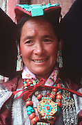 INDIA, LADAKH Portrait of a Tibetan woman wearing traditional dress and turquoise jewelry