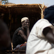 April 28, 2012 - Tabania, Nuba Mountains, South Kordofan, Sudan: A group of Nuba men recover from shrapnel injuries in a improvised field clinic near Tabania village in South Kordofan's Nuba Mountains in Sudan. ..Since the 6th of June 2011, the Sudan's Army Forces (SAF) initiated, under direct orders from President Bashir, an attack campaign against civil areas throughout the South Kordofan's province. Hundreds have been killed and many more injured...Local residents, of Nuba origin, have since lived in fear and the majority moved from their homes to caves in the nearby mountains. Others chose to find refuge in South Sudan, driven by the lack of food cause by the agriculture production halt due to the constant bombardments of rural areas. (Paulo Nunes dos Santos/Polaris)