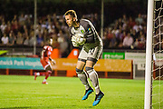 The ball strikes Ralf Fahrmann (GK) (Norwich) during the EFL Cup match between Crawley Town and Norwich City at The People's Pension Stadium, Crawley, England on 27 August 2019.