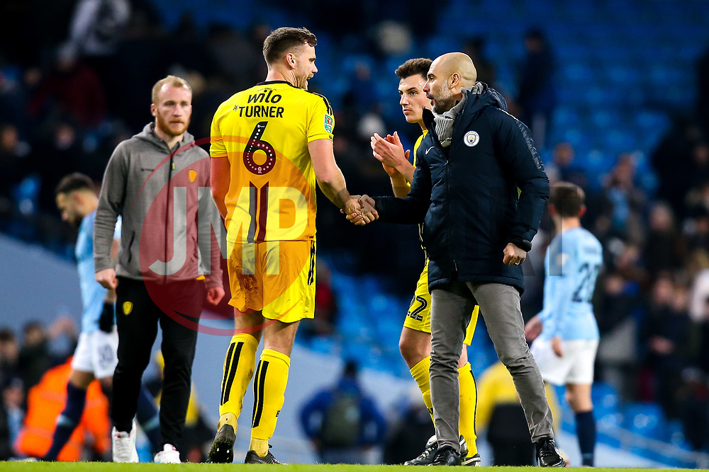 Manchester City manager Pep Guardiola shakes hands with Ben Turner of Burton Albion - Mandatory by-line: Robbie Stephenson/JMP - 09/01/2019 - FOOTBALL - Etihad Stadium - Manchester, England - Manchester City v Burton Albion - Carabao Cup