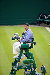 LONDON, ENGLAND - Monday, June 23, 2014: A chair umpire during the Gentlemen's Singles 1st Round match on day one of the Wimbledon Lawn Tennis Championships at the All England Lawn Tennis and Croquet Club. (Pic by David Rawcliffe/Propaganda)