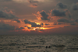 "© Licensed to London News Pictures. 02/06/2008. Phu Quoc Island,   FILE PHOTO : A picture shows the sun setting over the sea near a beach on Phu Quoc Island in Vietnam on 1 June 2008. A naval officer has today (08.03.2014) been quoted saying ""We have asked boats from Phu Quoc island to be prepared for rescue"" after Malaysian airlines flight MH370 went missing with 227 passengers on board. . Photo credit : /LNP"