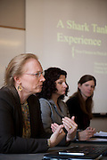 Faith Knotsen, left, Jennifer Simm, center, and Meredith Pizzi, right, judge and offer feedback to students who present their business proposals.