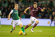 Daryl Horgan (#7) of Hibernian FC runs past Peter Haring (#5) of Heart of Midlothian during the Ladbrokes Scottish Premiership match between Hibernian FC and Heart of Midlothian FC at Easter Road Stadium, Edinburgh, Scotland on 29 December 2018.