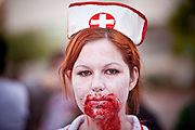 "Oct. 30, 2009 -- PHOENIX, AZ: ANNE STEGER, an Arizona State University student, walked as a Zombie nurse during the city's first ""Zombie Walk"" Friday night. About 200 people participated in the first ""Zombie Walk"" in Phoenix, AZ, Friday night. The Zombies walked through downtown Phoenix ""attacking"" willing victims and mixing with folks going to the theatre and downtown sports venues.  Photo by Jack Kurtz"