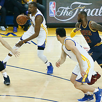 01 June 2017: Cleveland Cavaliers forward Kevin Love (0) defends on Golden State Warriors forward Kevin Durant (35) next to Cleveland Cavaliers forward LeBron James (23) and Golden State Warriors center Zaza Pachulia (27) during the Golden State Warriors 113-90 victory over the Cleveland Cavaliers, in game 1 of the 2017 NBA Finals, at the Oracle Arena, Oakland, California, USA.