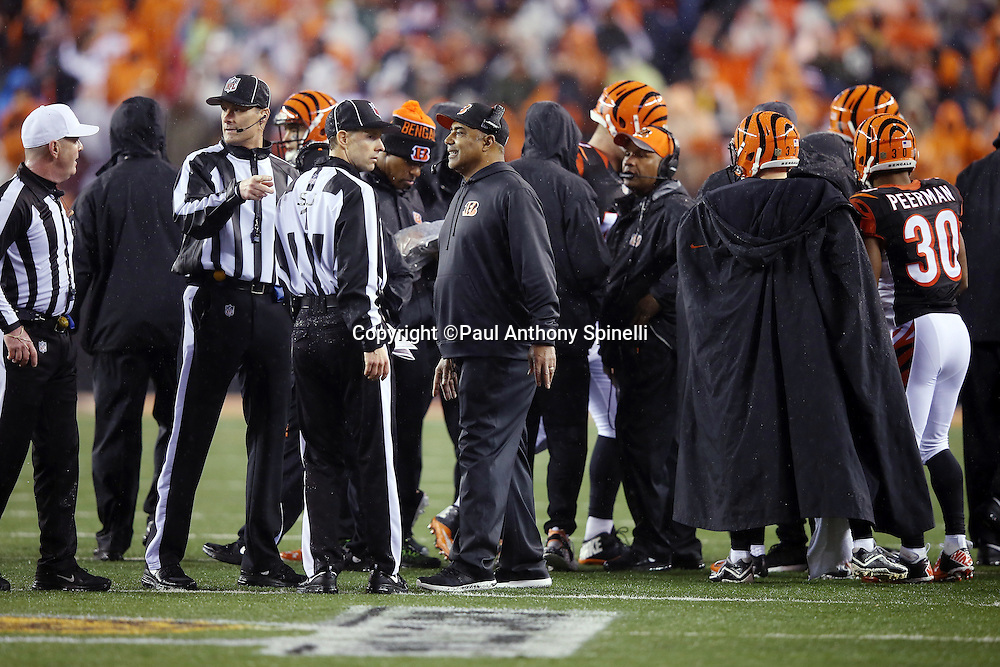 Cincinnati Bengals head coach Marvin Lewis talks to NFL officials on the sideline during the NFL AFC Wild Card playoff football game against the Pittsburgh Steelers on Saturday, Jan. 9, 2016 in Cincinnati. The Steelers won the game 18-16. (©Paul Anthony Spinelli)