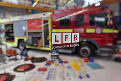 © Licensed to London News Pictures. 09/09/2017. London, UK. The contents of a current fire engine is laid out for visitors attending London Fire Brigade's annual Fire Engine Festival in Lambeth.  The earliest motorised fire engines still working, London Fire Brigade's brand new pump as well as firefighter uniforms are on display. Photo credit : Stephen Chung/LNP