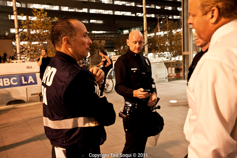 LAPD Commander Andrew Smith (center) coordinating the raid at Occupy LA..Hundreds of LAPD raid the Occupy LA camp located at LA city hall. Occupy LA has camped out on the lawn for two months, and was the largest of all the Occupy camps.Hundreds of LAPD raid the Occupy LA camp located at LA city hall. Occupy LA has camped out on the lawn for two months, and was the largest of all the Occupy camps.