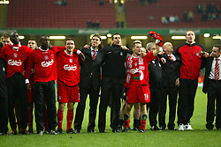 CARDIFF, WALES - Sunday, March 2, 2003: Liverpool players and officials(Djimi Traore, Emile Heskey, Vladimir Smicer, Patrik Berger, Markus Babbel, Michael Owen, Chris Kirkland) stand together and sing 'You'll Never Walk Alone' after beating Manchester United 2-0 to win the Football League Cup Final at the Millennium Stadium. (Pic by David Rawcliffe/Propaganda)
