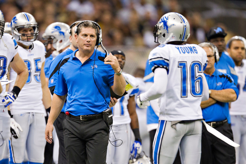 NEW ORLEANS, LA - DECEMBER 4:  Head Coach Jim Schwartz talks with Titus Young #16 of the Detroit Lions as he comes off the field during a game against the New Orleans Saints at Mercedes-Benz Superdome on December 4, 2011 in New Orleans, Louisiana.  The Saints defeated the Lions 31-17.  (Photo by Wesley Hitt/Getty Images) *** Local Caption *** Jim Schwartz; Titus Young