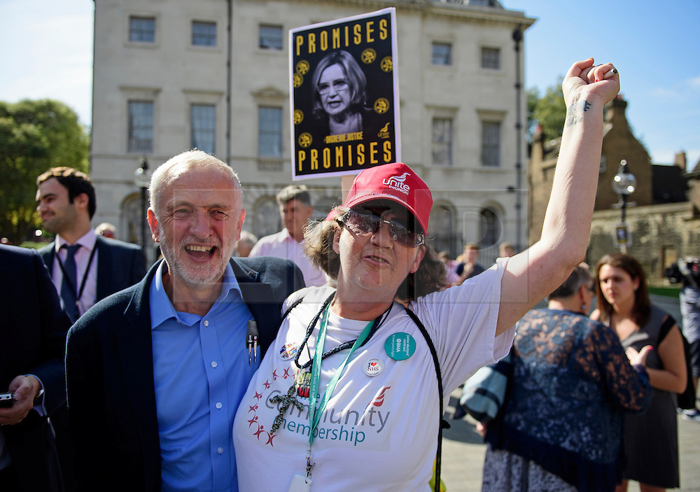 © Licensed to London News Pictures. 13/09/2016. London, UK.  Labour Party leader JEREMY CORBYN is joined by a supporter while attending a rally outside the Parliament in London for the Orgreave Truth and Justice Campaign, which calls for a public inquiry into the June 1984 confrontation between police and pickets at the British Steel Corporation coking plant in Orgreave, South Yorkshire. Photo credit: Ben Cawthra/LNP
