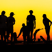 Silhoutte of skateboarders at sunset. taken in the Netherlands.