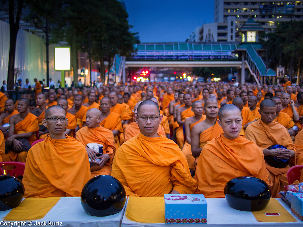 08 SEPTEMBER 2013 - BANGKOK, THAILAND: Buddhist monks pray in the dark before a mass alms giving ceremony in Bangkok. 10,000 Buddhist monks participated in a mass alms giving ceremony on Rajadamri Road in front of Central World shopping mall in Bangkok. The alms giving was to benefit disaster victims in Thailand and assist Buddhist temples in the insurgency wracked southern provinces of Thailand.      PHOTO BY JACK KURTZ