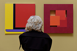 &copy; Licensed to London News Pictures. 08/06/2017. London, UK. A visitor views (L to R) &quot;Untitled (Yellow Laptop Fragment)&quot; by Sir Michael-Craig Martin RA (GBP40,000) and &quot;Thirds&quot; by John Carter RA (GBP10,000). Preview of the Summer Exhibition 2017 at the Royal Academy of Arts in Piccadilly.  Co-ordinated by Royal Academician Eileen Cooper, the 249th Summer Exhibition is the world's largest open submission exhibition with around 1,100 works on display by high profile and up and coming artists.<br />  Photo credit : Stephen Chung/LNP