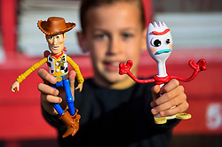 """© Licensed to London News Pictures. 13/11/2019. LONDON, UK. Charlie (aged 10) plays with Woody and Forky from Toy Story 4 True Talkers by Mattel at the preview of """"DreamToys"""", the official toys and games Christmas Preview, held at St Mary's Church in Marylebone.  Recognised as the countdown to Christmas, the Toy Retailer's Association, an independent panel of leading UK toy retailers, have selected the definitive and most authoritative list of which toys will be the hottest property this Christmas.  Photo credit: Stephen Chung/LNP"""