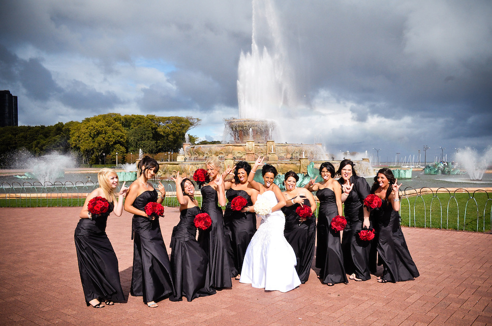 Tara & her bridesmaids in front of Buckingham Fountain, and a dramatic sky, Chicago, IL
