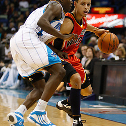 Mar 08, 2010; New Orleans, LA, USA; Golden State Warriors guard Stephen Curry (30) drives past New Orleans Hornets guard Darren Collison (2) during the first half at the New Orleans Arena. Mandatory Credit: Derick E. Hingle-US PRESSWIRE