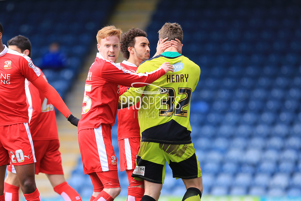 Brandon Ottewill congratulates Will Henry on his penalty save during the Sky Bet League 1 match between Rochdale and Swindon Town at Spotland, Rochdale, England on 30 April 2016. Photo by Daniel Youngs.