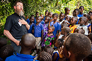 The Rev. Daniel Mulholland, team chaplain and pastor of Shepherd of the Valley Lutheran Church, Fort Bridger, Wyo., talks with children about Jesus Christ on the first day of the LCMS Mercy Medical Team on Monday, May 7, 2018, in the Yardu village outside Koidu, Sierra Leone, West Africa. LCMS Communications/Erik M. Lunsford