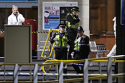 © Licensed to London News Pictures . FILE PICTURE DATED 01/01/2019 of police and forensic scenes of crime examiners working on a platform at Victoria Station in Manchester as Mahdi Mohamud is due to appear at Manchester Crown Court today (Tuesday 26 November 2019) charged  with 3 counts of attempted murder and 1 count contrary to Section 58 (1) (a), TACT 2000 which relates to the possession of a document or record likely to be useful to a person committing or preparing an act of terrorism . On the evening of 31st December 2018 , as thousands headed in to Manchester City Centre to watch New Years Day fireworks , three people including a British Transport Police Officer were stabbed and a man was tasered on a Metrolink platform of Victoria Train Station in Manchester . Photo credit : Joel Goodman/LNP