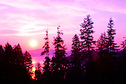 Sunrise over Lake Coeur D Alene, Idaho. Colors have been altered. PLEASE CONTACT US FOR DIGITAL DOWNLOAD AND PRICING.