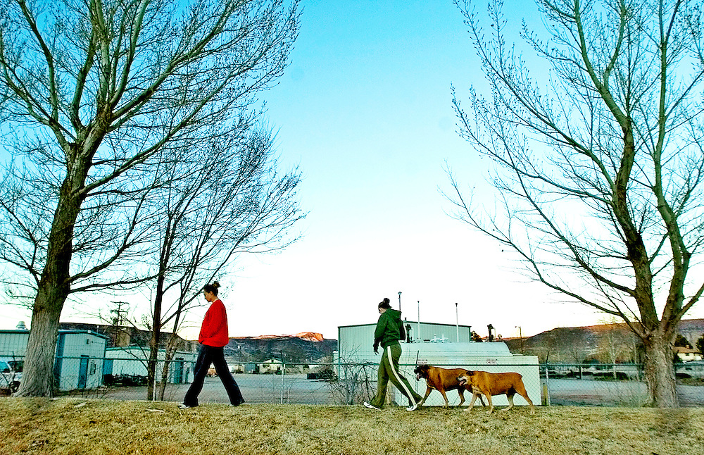 031307     Brian Leddy.Melanie and Sue Taylor walk with their dogs Nikki and Ginger on Tuesday at the new dog park in Grants. While the park is not yet dedicated, many dog owners have been taking advantage of the new area.