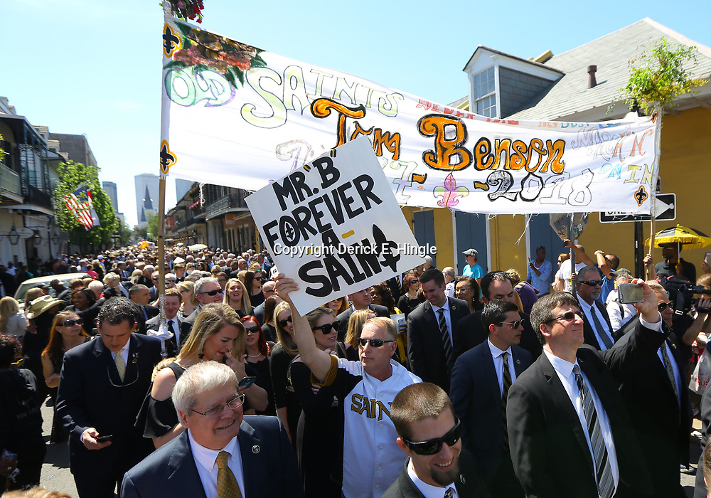 New Orleans Saints fan Larry Rolling of Mandeville, La holds up a sign during a second line following the funeral service for NFL New Orleans Saints owner and NBA New Orleans Pelicans owner Tom Benson in New Orleans, Friday, March 23, 2018. Benson died last Thursday at the age of 90. (AP Photo/Derick Hingle)