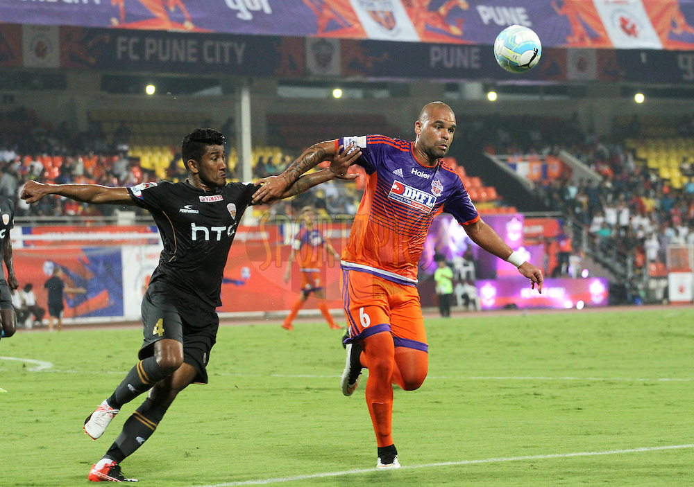 Nirmal Chettri of NorthEast United FC and Eduardo Ferreira of FC Pune City in action during match 11 of the Indian Super League (ISL) season 3 between FC Pune City and NorthEast United FC held at the Balewadi Stadium in Pune, India on the 12th October 2016.<br /> <br /> Photo by Vipin Pawar / ISL/ SPORTZPICS