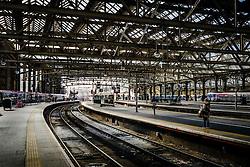 A woman passenger waits on a platform at Glasgow Central Station - the major mainline rail terminus in Glasgow, Scotland<br /> <br /> (c) Andrew Wilson   Edinburgh Elite media