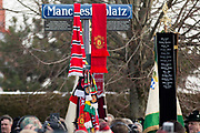 Scarves on the road sign during the ceremony at Manchesterplatz, Munich, Germany. Picture by Phil Duncan.