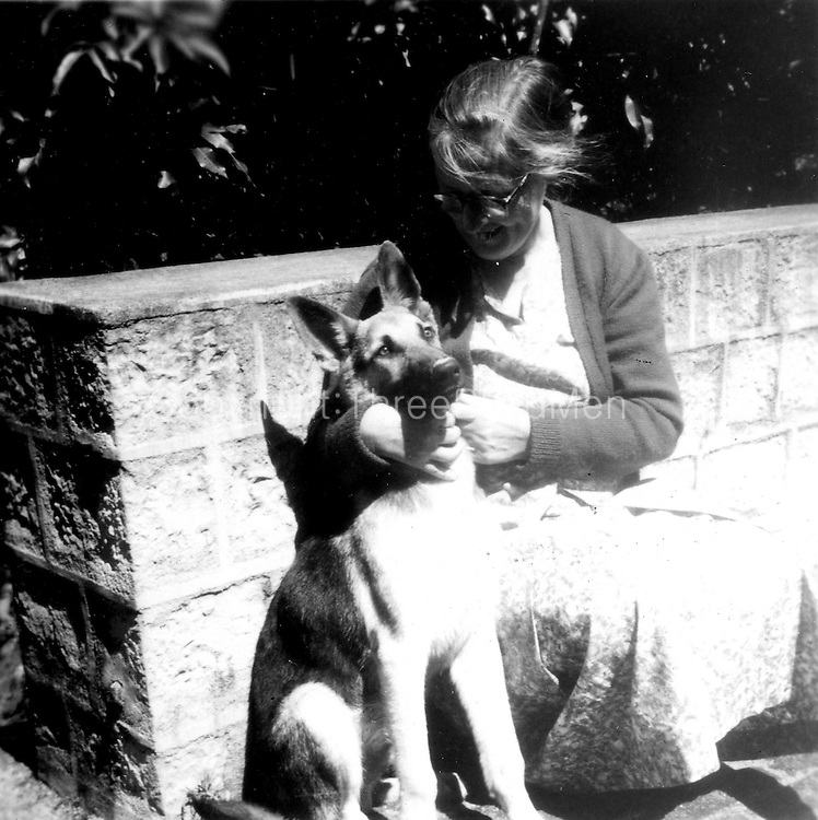 Peter Tennant Collection.  Mollie Tennant with dog, Elladuva Estate c.1961