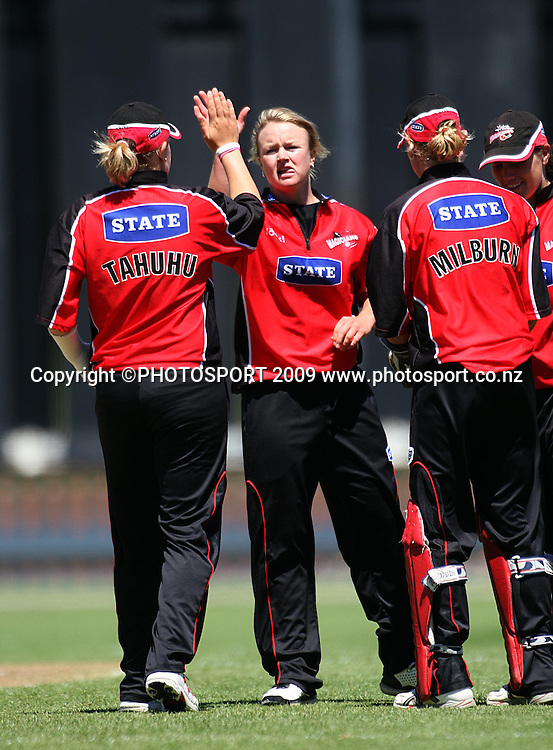 Lea Tahuhu congratulates Beth McNeill on dismissing kerri-Ann Tomlinson.<br /> State League final. Wellington Blaze v Canterbury Magicians at Allied Prime Basin Reserve, Wellington. Saturday, 24 January 2009. Photo: Dave Lintott/PHOTOSPORT