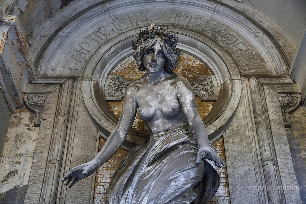 Genoa.  The Cimitero monumentale di Staglieno is famous for its monumental sculpture. Tomba Pizzorni by V. Lavezzari 1906. Covering an area of more than a square kilometre, it is one of the largest cemeteries in Europe.