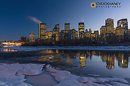 Winter city skyline reflects in the Bow River in Calgary, Alberta, Canada