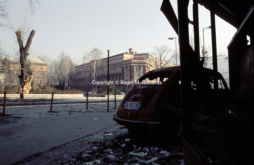 An intersection across the street from the Bosnian presidency building during the Bosnian Serb siege of Sarajevo, Bosnia and Herzegovina, December 1992. Almost 2,000 children, and over 10,000 people in total were killed in Sarajevo during the 3-1/2 year siege. (Photo by Roger Richards)