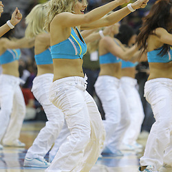 08 February 2009: The New Orleans Hornets Honeybees cheerleaders perform during a NBA game between the Minnesota Timberwolves and the New Orleans Hornets at the New Orleans Arena in New Orleans, LA.