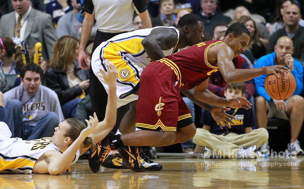 Dec. 30, 2011; Indianapolis, IN, USA; Cleveland Cavaliers point guard Ramon Sessions (3) grabs a loose ball as Indiana Pacers point guard Darren Collison (2) and Indiana Pacers center Louis Amundson (17) defend at Bankers Life Fieldshouse. Indiana defeated Cleveland 81-91. Mandatory credit: Michael Hickey-US PRESSWIRE