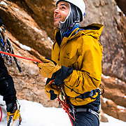 AMC Ice Climbing student belaying his leader at the base of Green Mile on Mount Webster