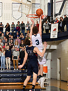 Seth Mann scores on a lay up in the 2nd quarter vs Boyne City