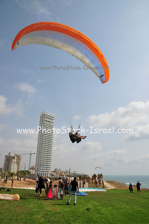 Israel, Sharon region, Netanya, Paragliding off the cliff of the promenade