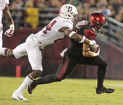 September 16, 2017 - San Diego, CA, USA - San Diego State wide receiver Mikah Holder, right, is tackled by Stanford's Quentin Meeks after Holder caught a pass in the second quarter at Jack Murphy Stadium in San Diego on Saturday, Sept. 16, 2017. (Credit Image: © Hayne Palmour Iv/TNS via ZUMA Wire)