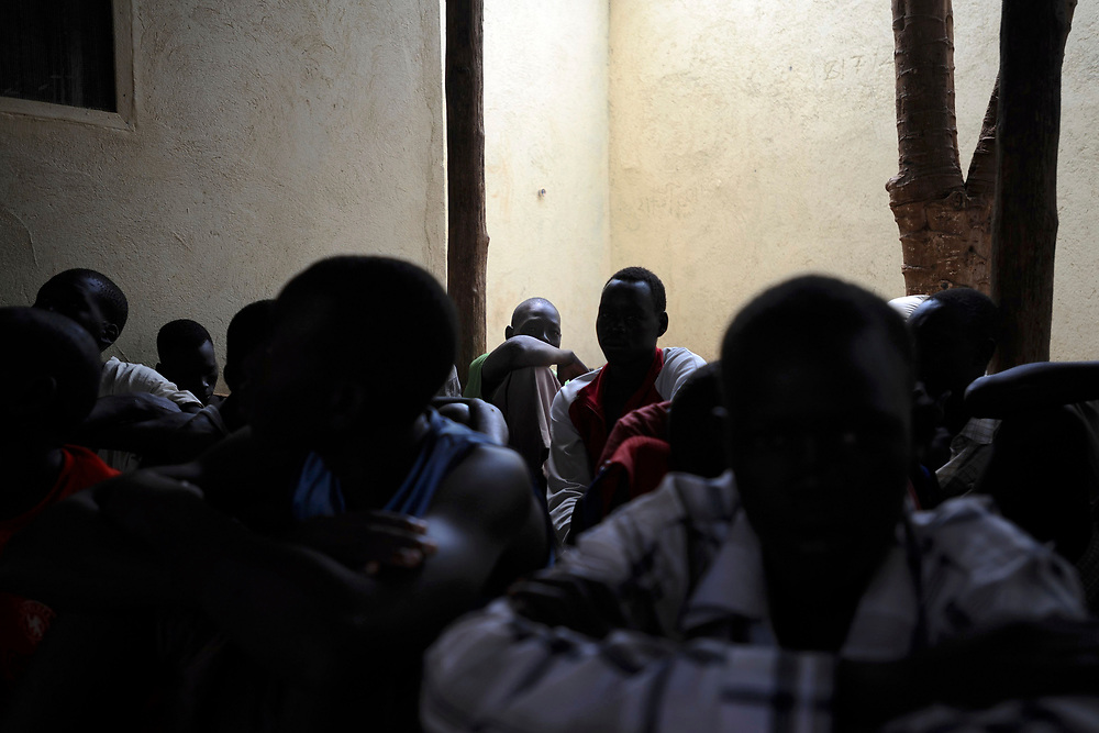 A group of child inmates gather in the juvenil patio area  of Juba Central Prison. The prison accommodates dozens of inmates with ages between fourteen and eighteen years old, many charged with murder and theft.