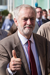 © Licensed to London News Pictures . 29/09/2015 . Brighton , UK . JEREMY CORBYN gives a thumbs up  to the crowd as he arrives at the 2015 Labour Party Conference , ahead of his speech . Photo credit : Joel Goodman/LNP